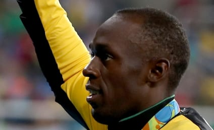 Usain Bolt: Caught in Bed with Another Woman!