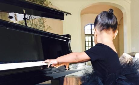 North West at the Piano
