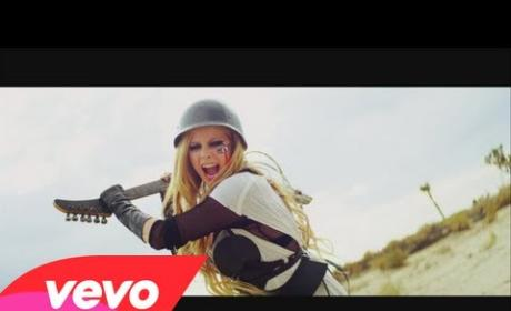 "Avril Lavigne, Danica McKellar Make Out in ""Rock N Roll"" Music Video"