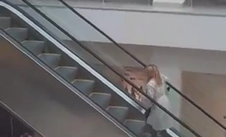 Girl Texts a Lot, Fails to Understand Escalator
