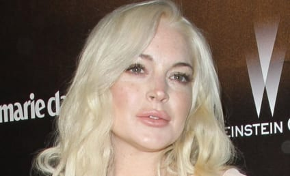Lindsay Lohan Denies Boozing, Henry Hopper Makeout Session