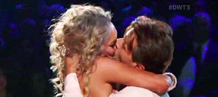 Robert Herjavec and Kym Johnson Kiss