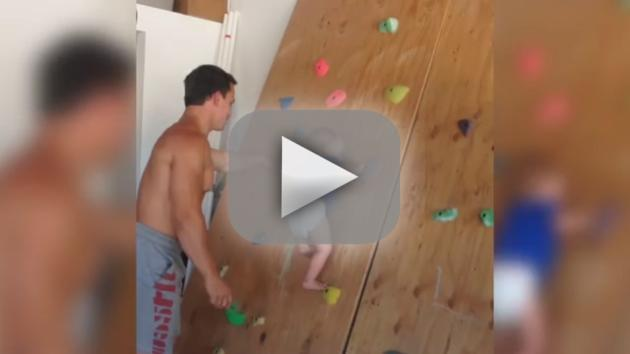 Baby Climbs Wall, Makes Dad Proud