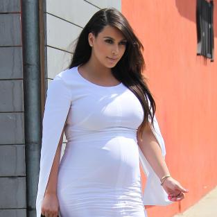 Pregnant Kim Kardashian in White