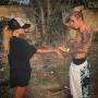 Justin Bieber Goes Shirtless, Poses with Mystery Woman