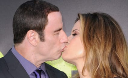 John Travolta, Kelly Preston Kiss at Savages Premiere