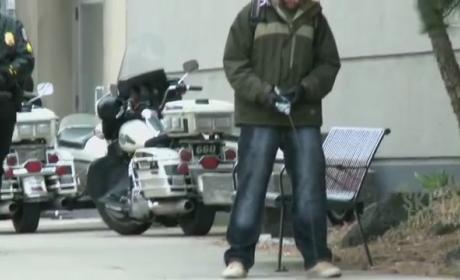 Guy Tests Water Bottle Stream on Steet, Pranks Cops