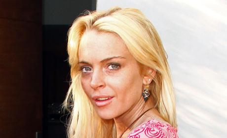 Lindsay Lohan Continues to Party the Pain Away