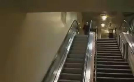 "Guy Tries, Fails to ""Fly"" Down Escalator"