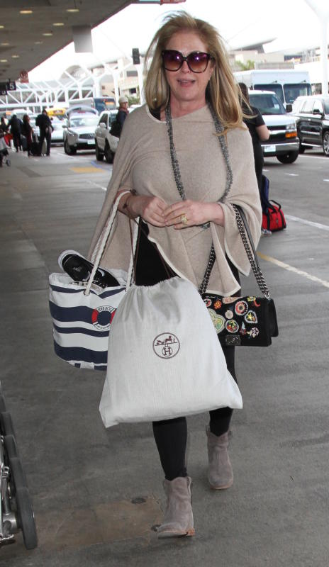 Kathy hilton catches a flight at lax