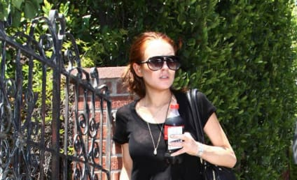 Lohan Questioned in Mother's Fraud Suit