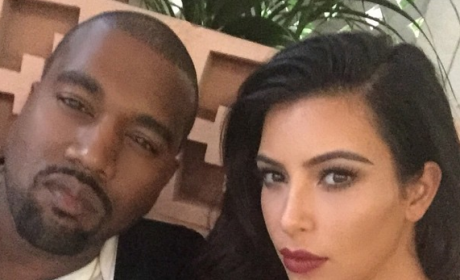 Kim Kardashian Suspects Kanye West of Fathering a Love Child, Tabloid Claims