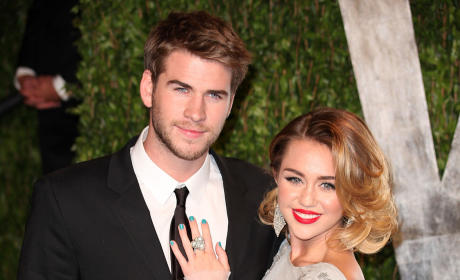 Tournament of THG Couples: Robert Pattinson & Kristen Stewart vs. Miley Cyrus & Liam Hemsworth!