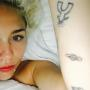 Miley Cyrus Planet Tattoo