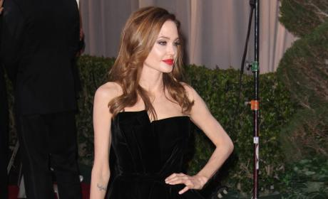 Academy Awards Fashion Face-Off: Angelina Jolie vs. Penelope Cruz