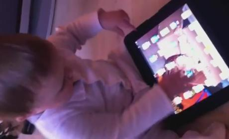 Little Kid Treats Magazines Like iPad