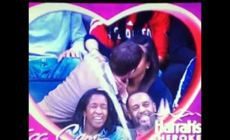Kiss Cam Couple Spills Beer on Fellow Fans