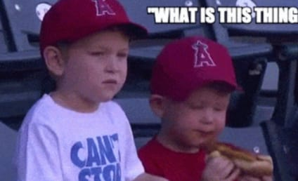 Adorable Baseball Fan is Very Confused by Hot Dog Bun