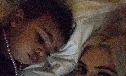 Kim Kardashian Posts Pic of North West in Bed With a Necklace On: Dangerous or Darn Cute?