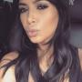 Kim Kardashian Hits Facebook Milestone, Puckers Up for Fans