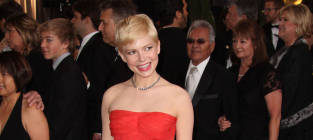 Academy Awards Fashion Face-Off: Emma Stone vs. Michelle Williams