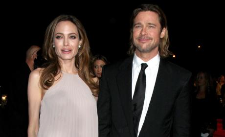 Brad Pitt: Injured Carrying Vivienne, Walking With Cane
