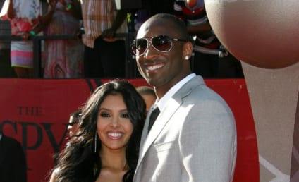Giant Boob Alert: Kobe Bryant, Wife's Cleavage