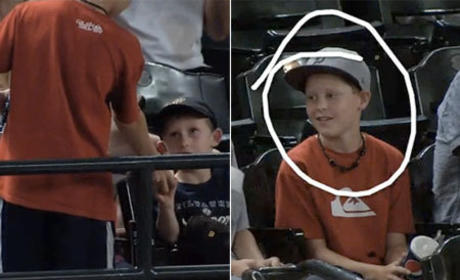 Young Fan Gives Ball to Younger Fan