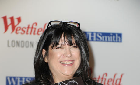 E.L. James holding Fifty Shades of Grey Novel