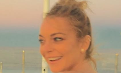 Lindsay Lohan Poses Topless, Gets Philosophical About Mermaids