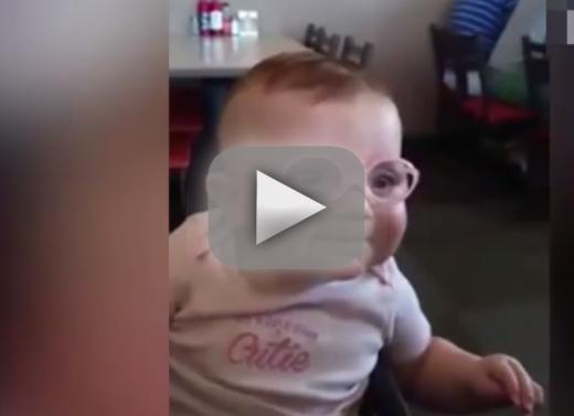 Baby puts on eyeglasses sees relatives for initial time