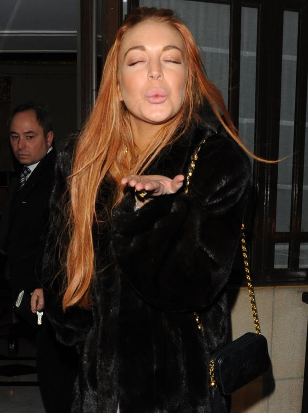 Lindsay Lohan Blows a Kiss