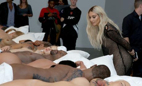 "Kim Kardashian Leering Over 'Famous"" Wax Bodies"