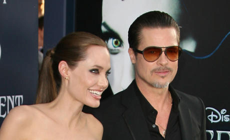 Brad Pitt Accosted by Infamous Celebrity Stalker at Maleficent Premiere