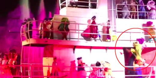 Dopey falls on top of Goofy during 'Fantasmic'