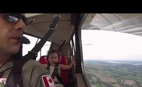 Girl Flies Upside in Airplane, Has Time of Her Life