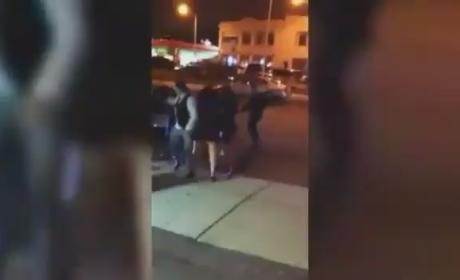 Cop Punches Woman in Face Outside Club [VIDEO]