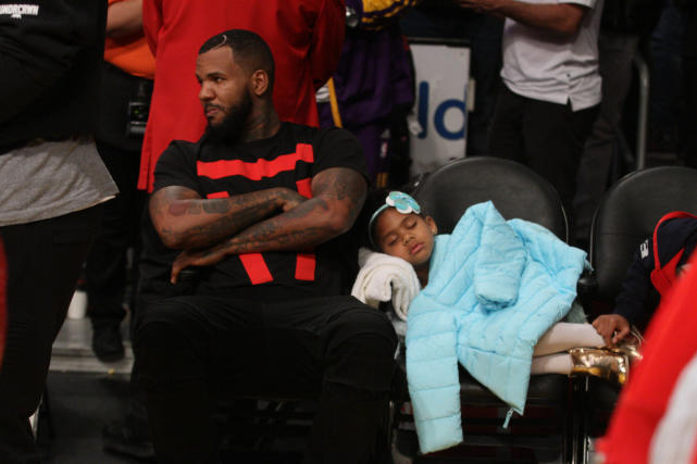 The games daughter takes a nap during the lakers game