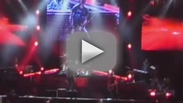 Axl Rose Falls on Stage
