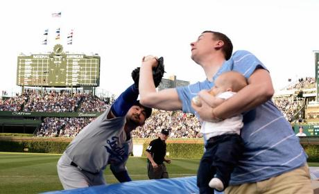 Father Holds Baby, Steals Foul Ball from Adrian Gonzalez