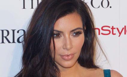 Kim Kardashian Talks Elf on the Shelf, Flaunts GIANT Boobs
