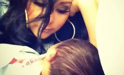 "Snooki Cuddles Baby Lorenzo, Proclaims ""I Love You"""