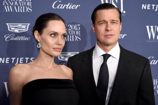 Angelina Jolie Pitt and Brad Pitt Pose Innovator Awards