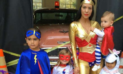 Kourtney Kardashian for Halloween: Super Cleavage, Super Kids!