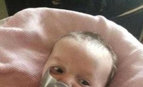 Grandmother Posts Facebook Photos of Duct-Taped Baby, Receives Police Visit
