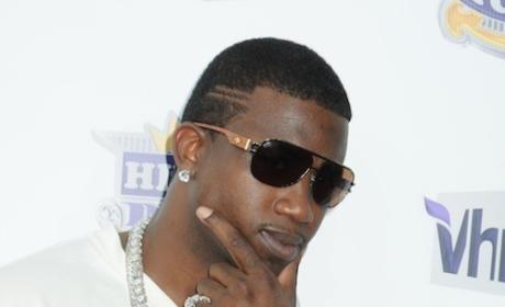 Gucci Mane Tattoos Face with Ice Cream Cone