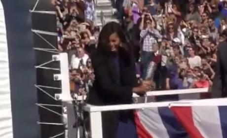 Michelle Obama Toughens Up, Smashes Champagne Bottle Like a Boss