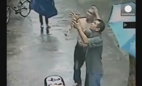 Baby Falls from Second Story Ledge in China, CAUGHT by Two Men: Watch Now!