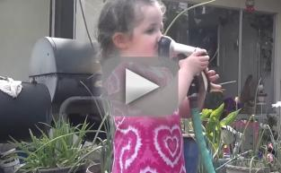 Young Girl Learns All About Water Pressure... The Hard Way