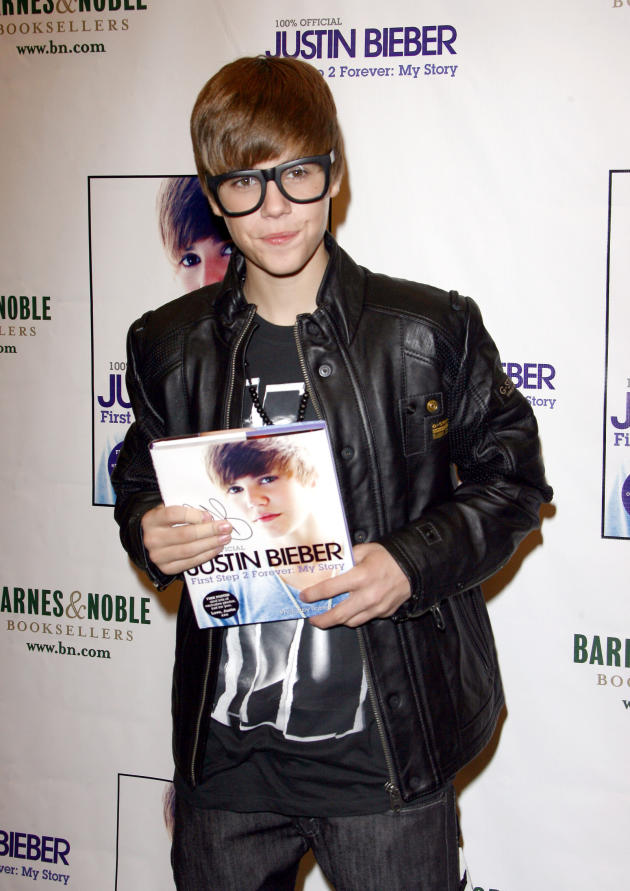 Holding His Book